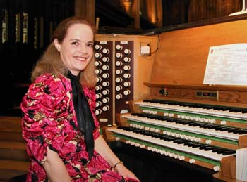 Photograph of Margaret Phillips at an organ console